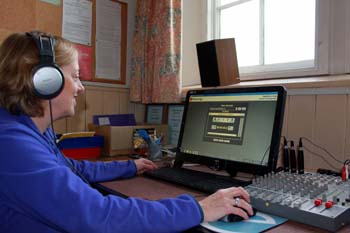 a volunteer editing audio files on the computer